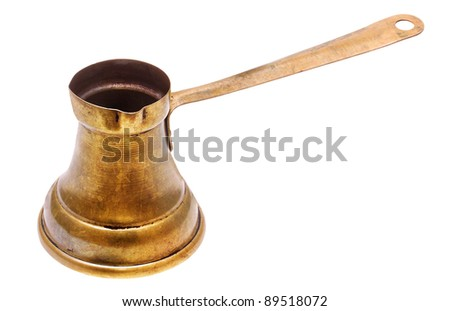 Old copper coffeepot with long handle on white - stock photo