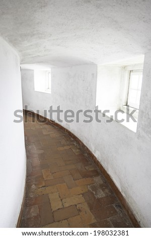 Old corridor with windows, detail of a hall in ancient catacombs - stock photo
