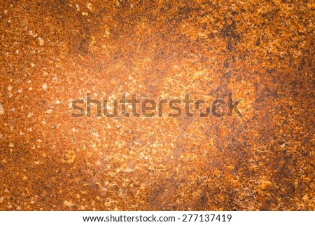 Old corroded metal background. Close up of rust. Damaged grungy metal background. - stock photo
