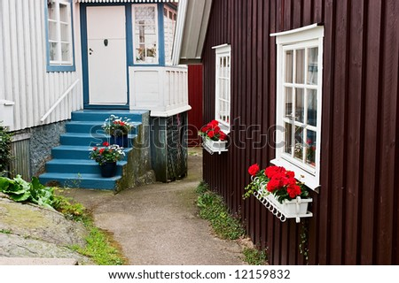 Old cottage in a small alley - stock photo