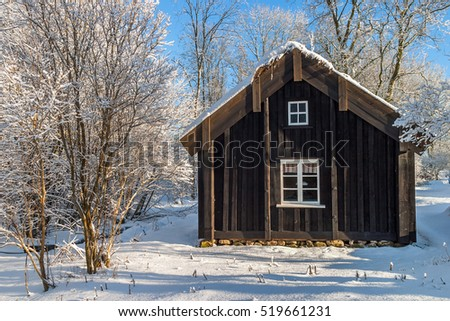 Old cottage in winter with snow