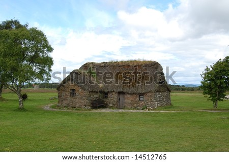 old cottage with thatched roof in scotland