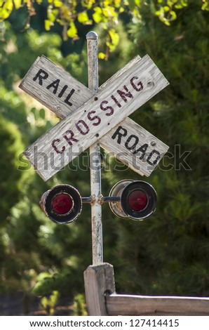 Old Country Railroad crossing sign - stock photo