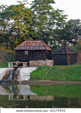 old country water mill. wooden water mill.
