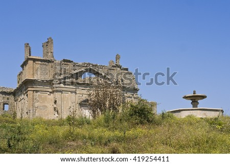 Old countryside house with fountain - stock photo