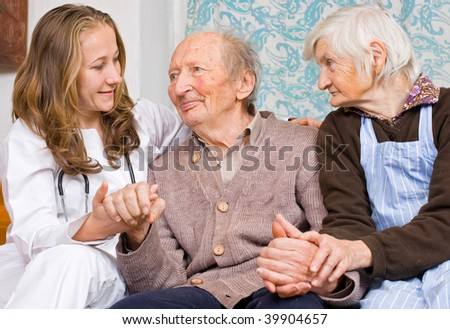 Old couple and the young sweet doctor - stock photo