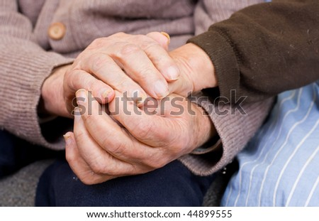 Old couple holding the hands