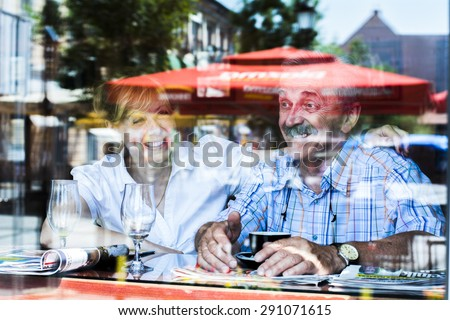 Old couple laughing  - stock photo