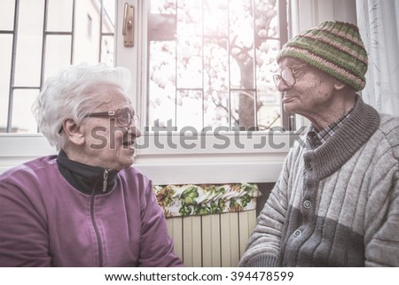 old couple portrait. grandparents posing for a family portrait - stock photo