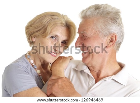 Old couple relaxing at home on a white