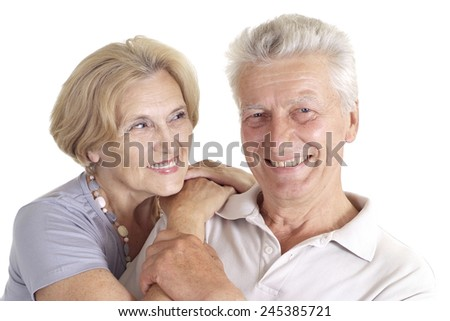 Old couple relaxing at home on a white - stock photo