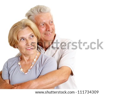 Old couple relaxing at home on a white background