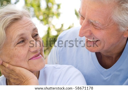 old couple resting in a summer park - stock photo