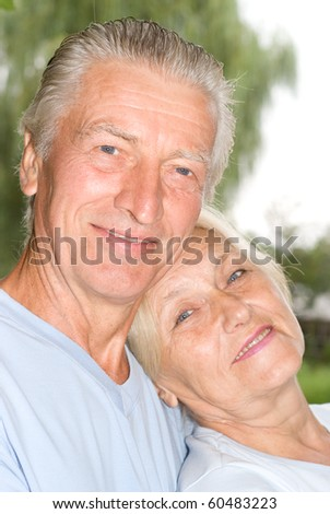 old couple resting in a summer park