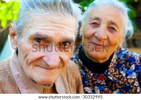 Old couple - two happy smiling seniors - stock photo