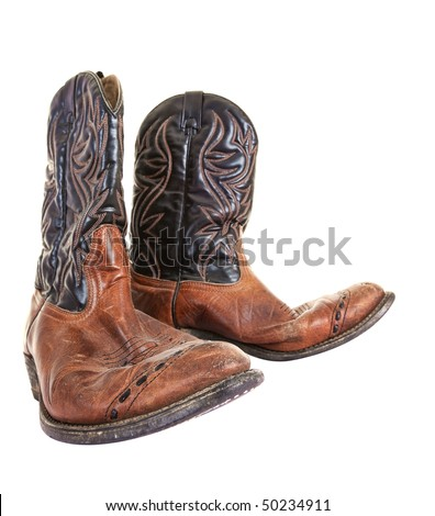 Old cowboy boots isolated on white background - stock photo