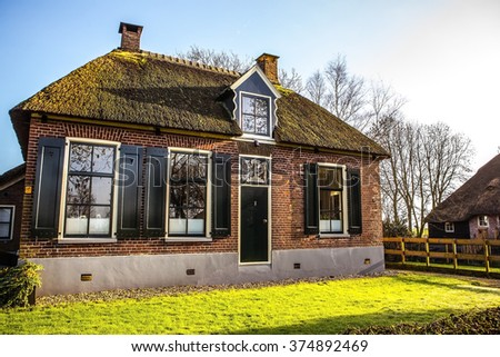 Old cozy house with thatched roof in Giethoorn, Netherlands.