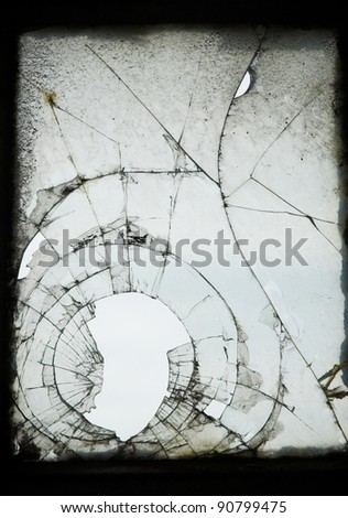 Old cracked and Broken Window in an industrial mill. - stock photo