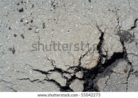 Old cracked asphalt closeup background. - stock photo