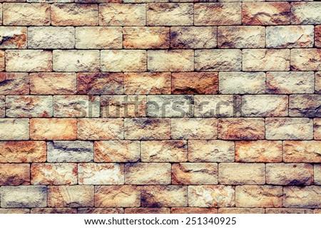old cracked brick stones wall background - stock photo