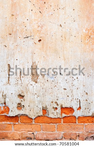 Old cracked brick wall for background - stock photo