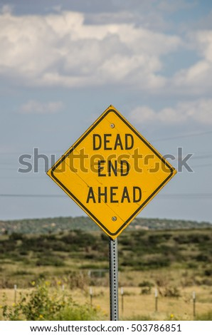 Old, cracked dead end ahead sign on Route 66 in New Mexico