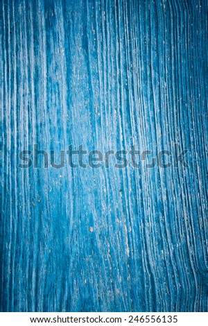 Old cracked painted texture. Rusty blue wood. Grunge background. - stock photo
