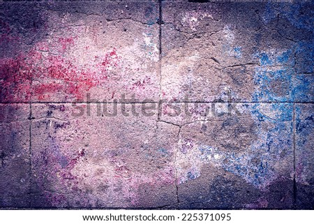 old cracked purple wall with remains of paint, abstract background - stock photo