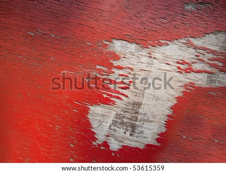 Old cracked red paint on wood