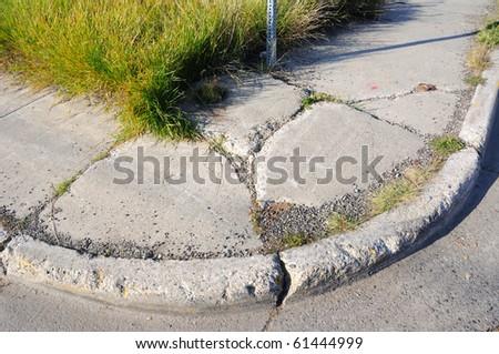 Old Cracked Sidewalk - stock photo