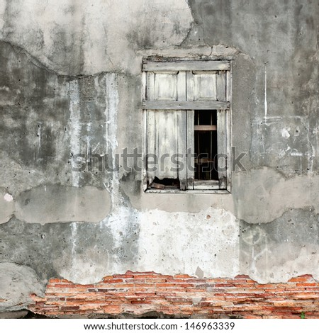 Old cracked wall with a window - stock photo