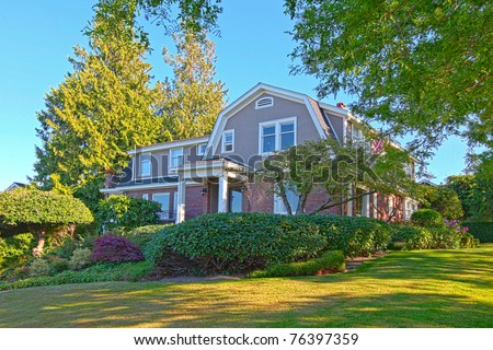 Old craftsman brick house with summer beautiful landscape - stock photo