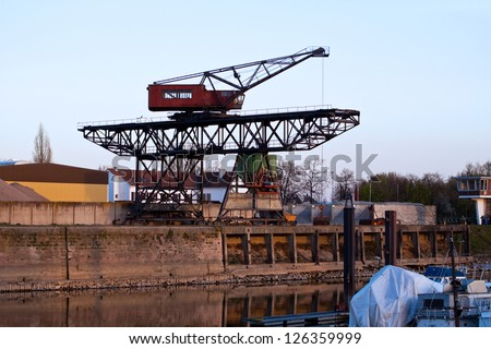 Old crane at a rhine harbor
