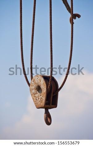 Old crane hook - stock photo