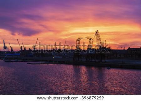 Old cranes in Szczecin at sunrise. Szczecin, West Pomeranian, Poland - stock photo