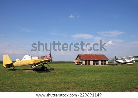 old crop duster airplanes on land airfield  - stock photo