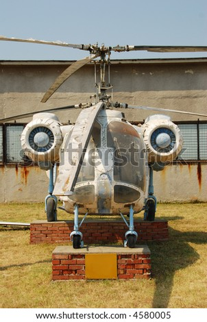 Old crop dusting helicopter in need of repair - stock photo