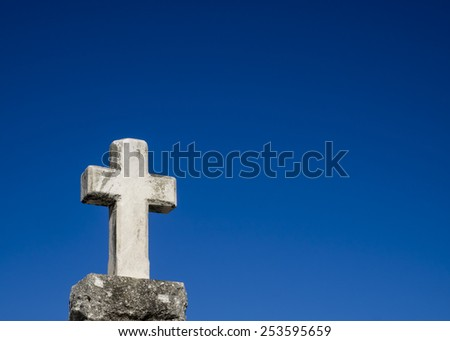 Old cross at cemetery. - stock photo