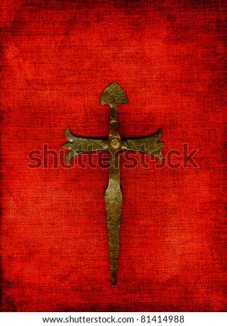 Old cross on a red background. - stock photo