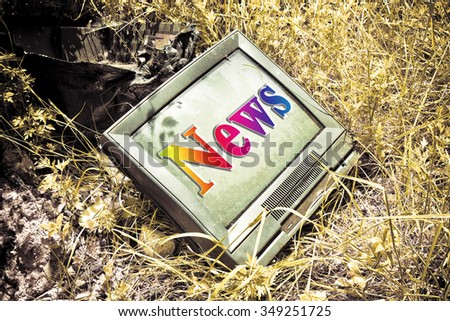 """Old CRT television with """"news"""" written on screen - stock photo"""