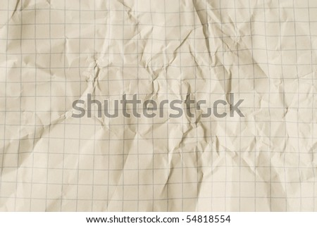 Old crumpled squared paper (as a background) - stock photo