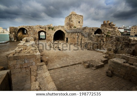 Old crusaders castle of 13th century into the sea in Saida with dramatic sky, Lebanon - stock photo