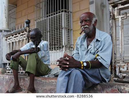 Old cuban men from Trinidad - stock photo