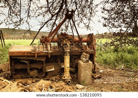Old cultivator agricultural machinery - stock photo