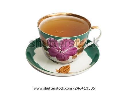 Old cup with tea on a white background  - stock photo