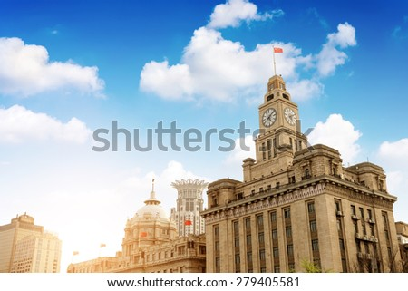 Old Customs Building with Clock and Flag, The Bund, Shanghai, China. The Customs Building was built in 1927. - stock photo