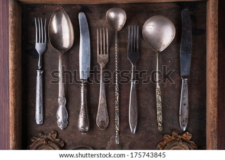 Old cutlery in an old wooden box - stock photo