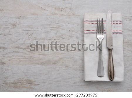 Old cutlery on cloth - stock photo