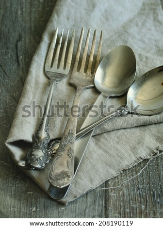 old cutlery on wooden table - Vintage silverware on rustic wooden background