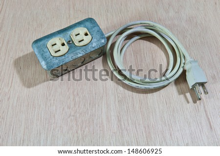Old damage Extension cord on wood background - stock photo